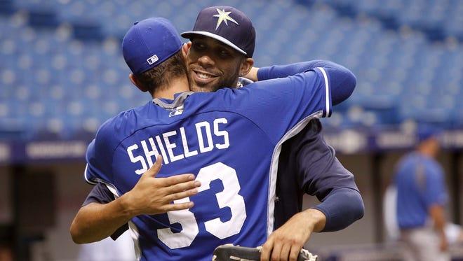 Kansas City Royals starting pitcher James Shields (33) and Tampa Bay Rays starting pitcher David Price hug before a game.