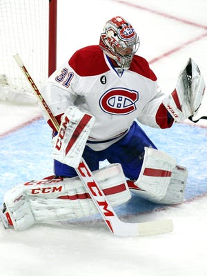 Montreal Canadiens goalie Carey Price (31) makes a save against Ottawa Senators during the first period in the game six of the first round of the 2015 Stanley Cup Playoffs at the Canadian Tire Centre.