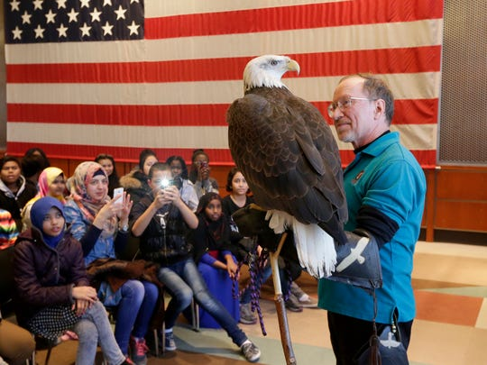 Schlitz Audubon rapture volunteer Ken Wardius, holds