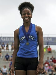 Cedar Crest's Destinee Holloman returns after medaling in the long jump at last year's state meet and qualifying for the 100-meter dash.