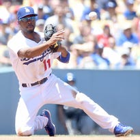 LOS ANGELES, CA - AUGUST 01: Jimmy Rollins #11 of the Los Angeles Dodgers makes a throw to second for a force out of Erick Aybar #2 of the Los Angeles Angels during the second inning at Dodger Stadium on August 1, 2015 in Los Angeles, California. (Photo by Harry How/Getty Images)