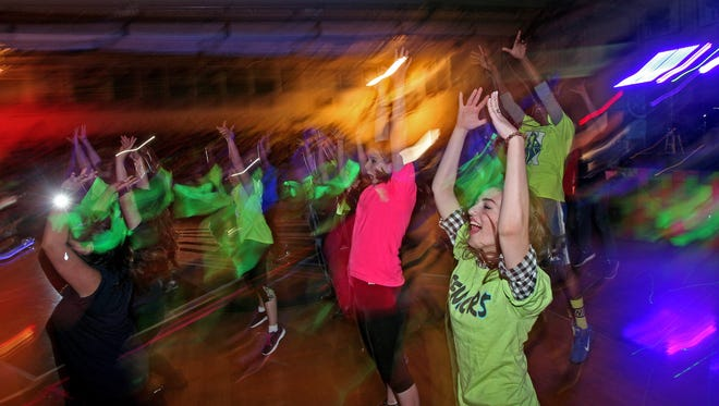 Teachers and students dance to Uptown Funk as Roxbury High School hosts their 2nd annual nine hour mini-THON, a dance/celebration to raise money for families facing pediatric cancer. April 17, 2015. Roxbury, N.J. Bob Karp/Staff Photographer.
