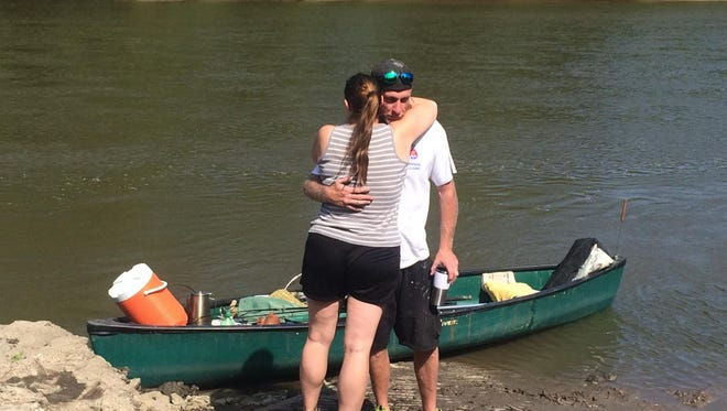 Missing canoeist Justin Reimann reunites Friday with his girlfriend, Billie Armstrong at the Walnut Woods boat ramp in West Des Moines.