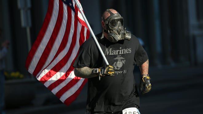 Darth Vader, 44, of Canandaigua runs the Flower City Half Marathon in April, 2016.