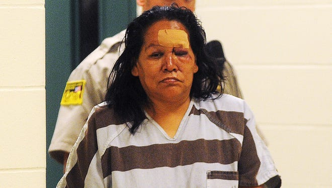 Lois F. Two Bulls is escorted into Minnehaha County Court on July 14, 2014, in Sioux Falls.
