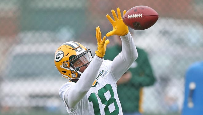 Green Bay Packers wide receiver Randall Cobb (18) catches a pass during Green Bay Packers organized team activities Tuesday, May 23, 2017 at Clarke Hinkle Field.
