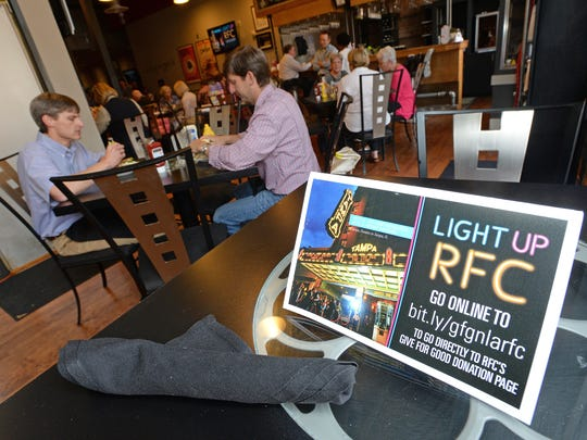 Place cards on the tables of Abby Singer's Bistro remind patrons to donate to the Robinson Film Center for a marquee during the 2015 Give for Good Day.   The online giving challenge raised $1.7 million for 156 local organizations.