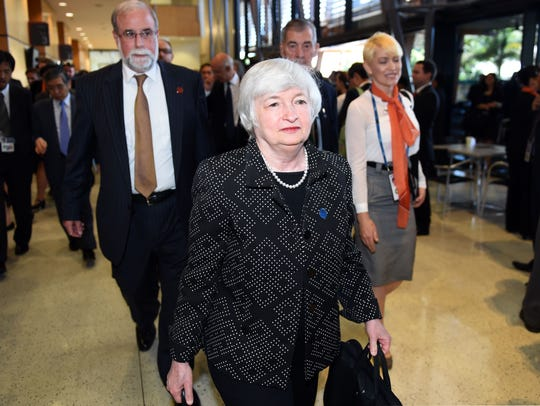 Federal Reserve Chairwoman Janet Yellen (C) arrives