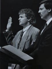 Former MSU Spartan Blake Ezor, is sworn in in court with is attorney Brian Jeffries, Oct. 29, 1990. Ezor pleaded guilty to attempted retail fraud from the Okemos Meijer. He was ordered to do 24 hours of community service and to pay $300 and court costs.