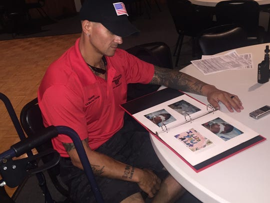 Jason Picaro reviews photos and mementos of his accident that were collected by his mother.