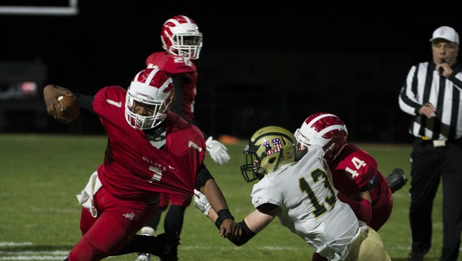 Delsea senior running back Rashaad Williams looks to break away from a Seneca defender during last week's S.J. Group 3 first-round playoff game.