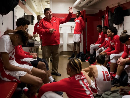 Bosse Head Coach Shane Burkhart talks to his team in