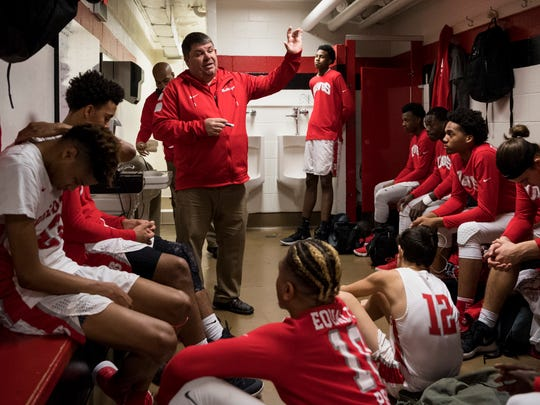Bosse Head Coach Shane Burkhart talks to his team in the locker room before the first IHSAA Class 3A Regional Tournament game against the Greensburg Pirates at Memorial Gym in Huntingburg, Ind., Saturday, March 10, 2018. The Bulldogs defeated the Pirates, 75-58, to advance to the evening's Regional Championship game.