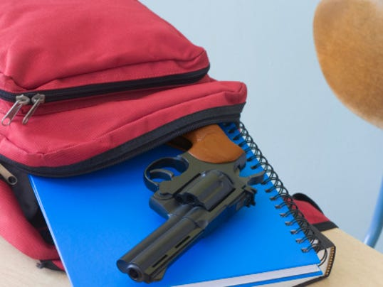 CPO- gun in school stock image