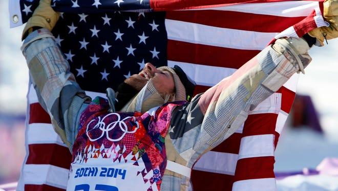 Sage Kotsenburg celebrates after winning gold in men's slopestyle.