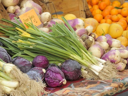 Organic fruit and vegetables from K.M.K. Farms in Kingsburg at the Farmers Market in downtown Visalia in 2010.