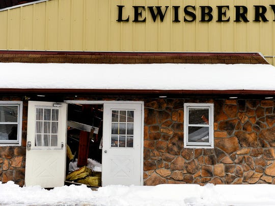 A Lewisberry borough building, partially leased out to the Fairview Township Fire Department, suffered a partial roof collapse over what was the social hall on Thursday, Feb. 13, 2014. Parts of the remaining roof are bowing under the weight of snow and ice, and the entire building has been deemed structurally unstable. The National Weather Service predicted a total of 10-18 inches of snow will have fallen by the conclusion of a storm that began late in York County, Pa., on Wednesday, Feb. 12, 2014, and continued through Thursday afternoon. Chris Dunn Ñ Daily Record/Sunday News