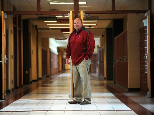 Principal Jon Wiltzius stands in the hallway of Fond du Lac High School. He is leaving the post at the end of June to operate Breezy Hill Campground near Eden.