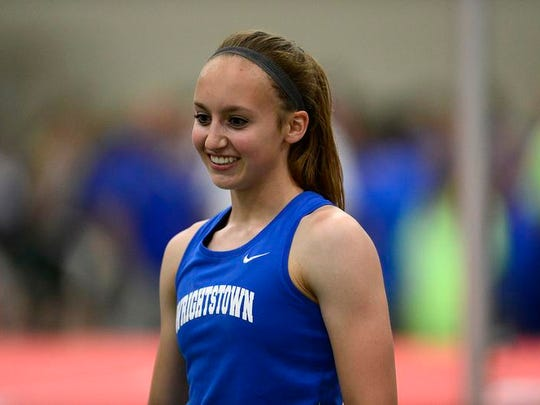 Wrightstown's Bonnie Draxler is all smiles after competing and winning the Div. 2 pole vault during the 2014 WIAA state track and field championships.