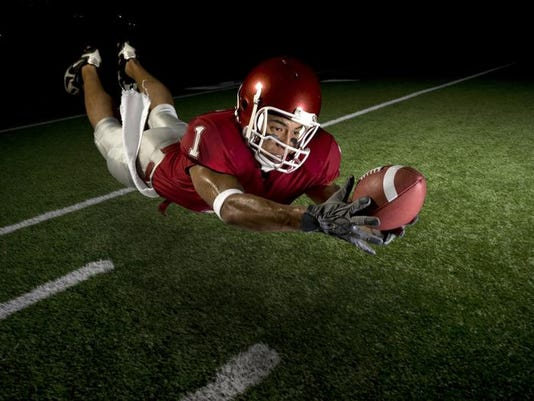 football_receiver_catching in air.jpg