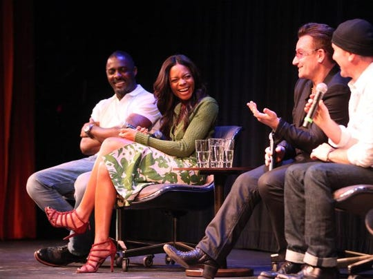 "Actors Idris Elba (from left), Naomie Harris, and U2's Bono and The Edge talk about the movie ""Mandela: Long Walk to Freedom"" during the Palm Springs International Film Festival's Talking Pictures at the Annenberg Theatre on Sunday."