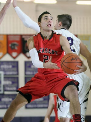 Spartan senior Ryan Maniaci floats along the baseline for a shot attempt during the Mount Gilead's home game against Pleasant on Tuesday.