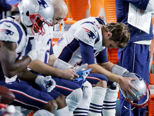 FILE - In this Monday, Dec. 11, 2017, file photo, New England Patriots quarterback Tom Brady (12) sits on the bench during the end of the second half at an NFL football game against the Miami Dolphins, in Miami Gardens, Fla. The Patriots defense couldn't have been worse in their first four games. During a dominating win streak over its next eight it was the NFL's stingiest, despite losing captain Dont'a Hightower to a season-ending injury. But after getting roughed up in its loss to Miami on Monday, a rapidly-depleting unit will have to turn the page quickly before its pivotal matchup with Pittsburgh. (AP Photo/Lynne Sladky, File)