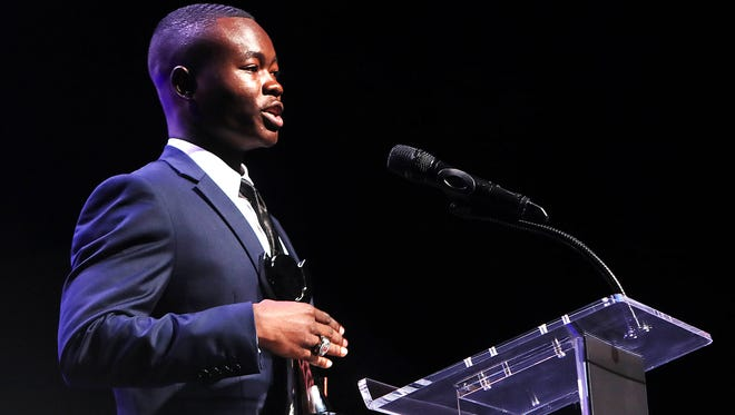 Kicker Ntirenganyi Karamba accepts the Courage Award during the annual Commercial Appeal Sports Awards at the Orpheum Theatre Tuesday evening.