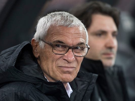 Egypt's Coach Hector Cuper watches the match during the friendly soccer game Egypt against Greece at the Letzigrund stadium in Zurich, Switzerland, Tuesday, March 27, 2018. (Ennio Leanza/Keystone via AP)