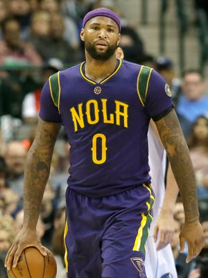 New Orleans Pelicans forward DeMarcus Cousins (0) holds the ball after being called for a travel during the second half of an NBA basketball game against the Dallas Mavericks in Dallas, Saturday, Feb. 25, 2017.
