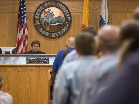 Doña Ana County Commisioner Benjamin Rawson listens