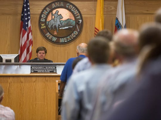 Doña Ana County Commisioner Benjamin Rawson listens to residents as they voice their opinions and concerns in regard to resolution supporting the Department of the Interior's review of the private land in the Organ Mountain Desert Peaks National Monument . Tuesday, June 27, 2017 at the Doña Ana County Government Center. Rawson's resolution was voted down during the meeting.