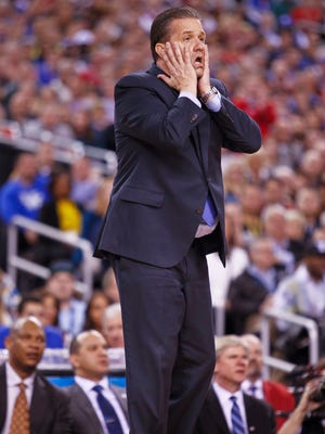 Kentucky's John Calipari reacts as the Wildcats falter late in the second half as Wisconsin beat Kentucky 71-64 Saturday night in the Final Four. By Matt Stone, The C-J April 4, 2015.