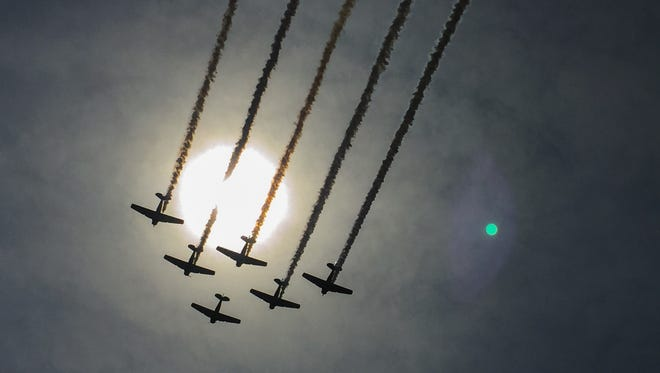 The GEICO Skytypers Air Show Team perform Sunday at the final day of the Melbourne Air & Space Show at Orlando Melbourne International Airport.