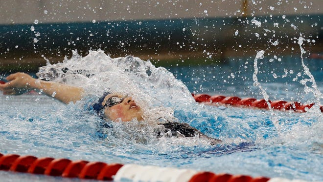 Sacred Heart's Asia Seidt competes in and wins the 00 yard Backstroke at the KHSAA Swim & Diving Championship.  Feb. 27, 2016