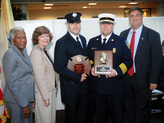 Union County Freeholders Vernell Wright (far left), Bette Jane Kowalski (second from left) and Alexander Mirabella (far right) congratulate Jason Cruz (second from right) of the Cranford Fire Department on graduating from the Union County Fire Training Academy as part of the Fall 2015 Class and earning the Battalion Chief Ken Nocera Memorial Award for Outstanding Excellence in Firefighter 1 and the Ben Laganga Leadership Award during a graduation ceremony at Union County College in Cranford. They are joined by Cranford Fire Chief Daniel Czeh.