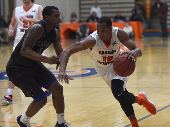 Lincoln Memorial's Cornelius Taylor, left, guards Carson-Newman's Charles Clark at Holt Fieldhouse in Jefferson City on Wednesday, Jan. 17.