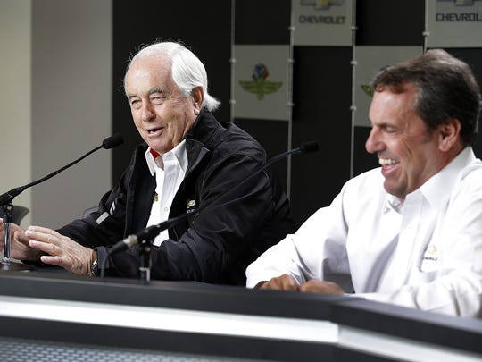 Team Penske owner Roger Penske talks with Mark Reuss,