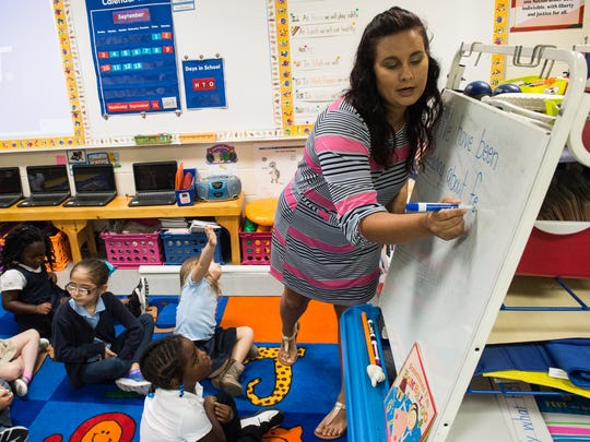 Chipman Elementary teacher Danielle Thompson works with students on a writing exercise on Thursday, Sept. 14, 2017.