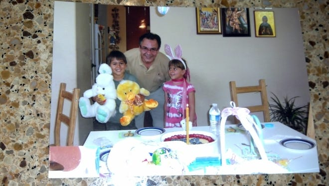 Ivan Krstic is pictured with his two young children in a personal photograph.