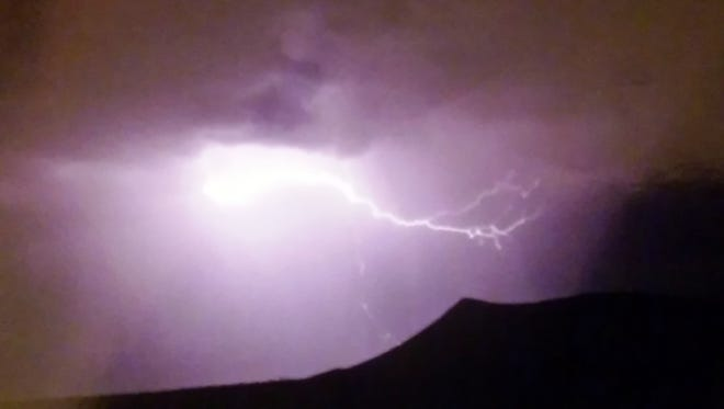 "Local ""Save Black Mountain"" activist Katherine Peterson took this lightning strike photo during recent thunderstorms near Black Mountain on Deming's northwest side of town. Peterson is fascinated with storm photography and has a collection of lightning photos she has taken over the years. Unfortunately, the storms are skipping past Deming city limits and keeping residents from much-needed rain."