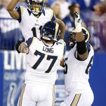 St. Louis Rams wide receiver Tavon Austin (11) celebrates another touchdown with St. Louis Rams tackle Jake Long (77) in first half action. The Rams beat the Colts 38-8 on Sunday, Nov. 10, 2013, in Indianapolis. (Sam Riche/MCT)