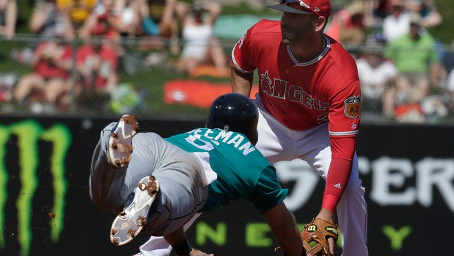 Seattle's Mike Freeman  steals second base in the second inning Sunday as the Los Angeles Angels'  Danny Espinosa waits for the throw.