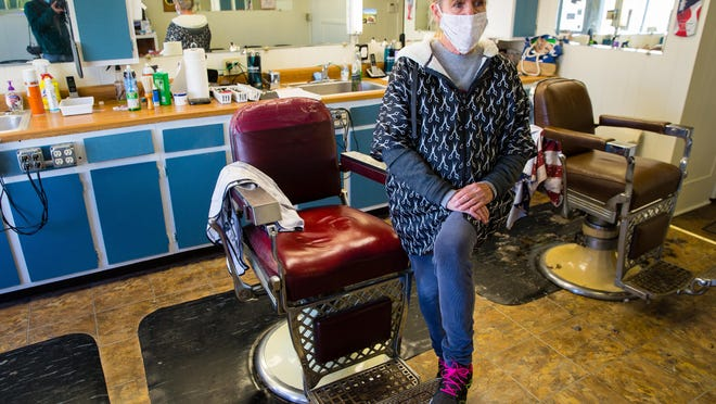 Donna Williams at Avenue Barber Shop in Springfield, Ill., Wednesday, Nov. 11, 2020.