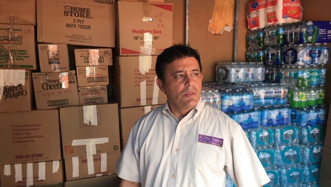 Javier Molinares, president of the Brevard Hispanic Center in Palm Bay, stands with supplies headed to Puerto Rico