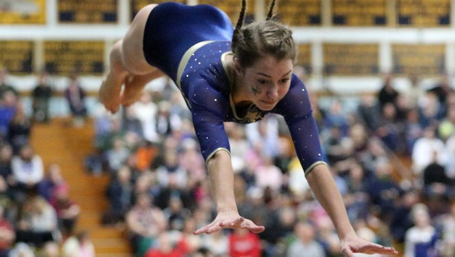 Essex junior Allison Green performs on the vault during the 2017 State Championship. Green won the overall individual state title while Essex took home the team championship.