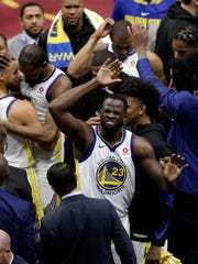 Golden State Warriors' Draymond Green celebrates after Game 3 of basketball's NBA Finals, Wednesday against the Cleveland Cavaliers, June 6, 2018, in Cleveland. The Warriors defeated the Cavaliers 110-102 to take a 3-0 lead in the series. (AP Photo/Tony Dejak)