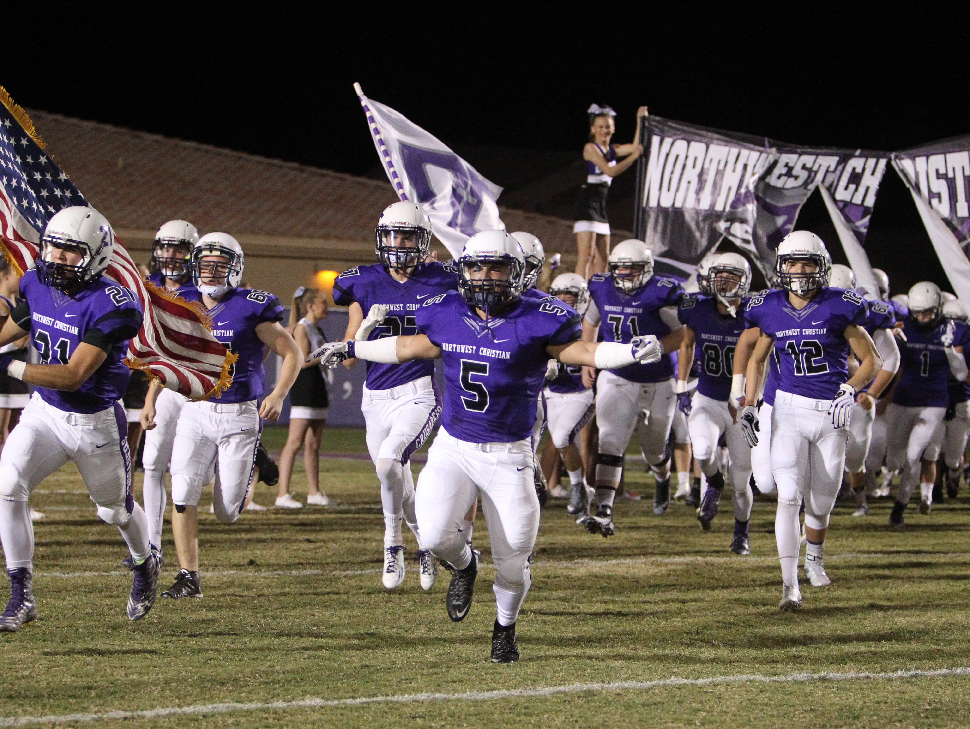 The Crusaders take the field before playing a football game at Northwest Christian School in Phoenix, Arizona on October 30, 2015.