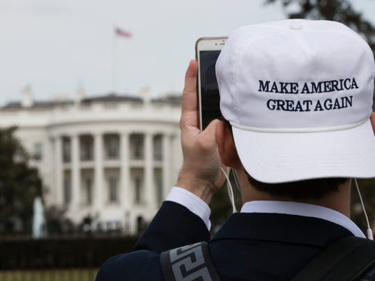 A man photographs the White House in Washington Thursday ahead of Friday's inauguration of Donald Trump.