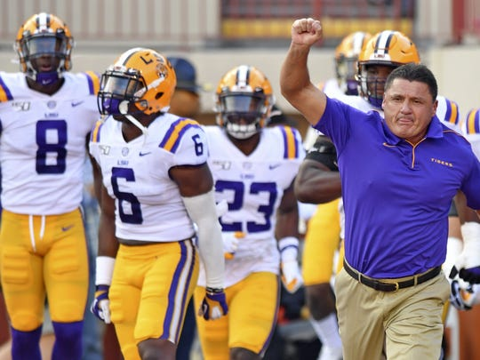 LSU coach Ed Orgeron takes the field with his players for an NCAA college football game against Texas on Saturday, Sept. 7, 2019, in Austin, Texas. (Hilary Scheinuk/The Advocate via AP) ORG XMIT: LABAT326